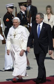 Pope Benedict XVI, left, walks with President Bush, right, during the arrival ceremony Tuesday at Andrews Air Force Base, Md.