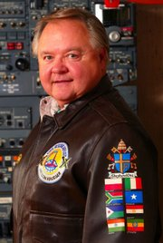"Nelson Krueger piloted ""Shepherd One,"" a Boeing 727, during Pope John Paul II&squot;s 1979 U.S. visit. The Shepherd One insignia is on the sleeve of his jacket."