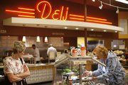Customers browse a salad buffet in The Merc's deli, 901 Iowa, in this 2008 file photo.