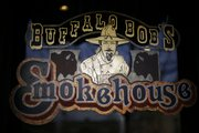 Signage for Buffalo Bob's Smokehouse, owned by Bob Schumm, Mass Street Deli's owner.