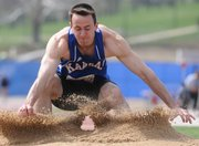 KU's Jacob Breth hits the sand pit after taking a run at the long jump. Breth sits in seventh place after the first day of the decathlon at the Kansas Relays on Wednesday at Memorial Stadium.