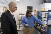 Kansas Secretary of Agriculture Adrian Polansky, left, listens to Susan Williams, associate professor of chemical and petroleum engineering at Kansas University, explain the process of producing biofuels in a research facility in Burt Hall.  Polansky visited campus in September 2007 to learn more about KU research initiatives involving biorefining and biofuels.