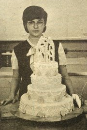Meri Sprung displays her finished wedding cake project that was featured in a 1965 issue of The Chieftain.