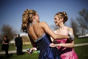 WHS senior Carrie Shirk, left, and sophomore Jenna Phillips greet each other before prom Saturday, April 19, 2008.