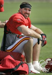Defensive end Jared Allen has his pads adjusted during the Chiefs' preseason training camp in River Falls, Wis., in this file photo from July 28. The Chiefs traded Allen to Minnesota on Wednesday, and the Vikings made him the highest-paid defensive player in the NFL.