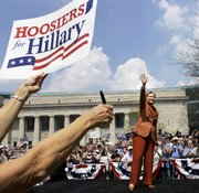 Democratic presidential hopeful Sen. Hillary Rodham Clinton, D-N.Y., waves after her speech as a supporter holds a sign for her to autograph at a rally in Indianapolis. Indiana and North Carolina have primaries next week.