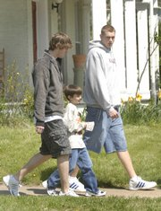 New York Elementary fourth-grader Kai Blosser, 10,  paired up with KU men's basketball players Conner Teahan, left, and Cole Aldrich during the LPS On the Move program.