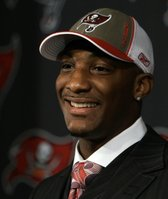 Tampa Bay Buccaneers cornerback Aqib Talib smiles at his introductory news conference. Talib, a former Kansas University All-American, met the media Monday in Tampa, Fla.