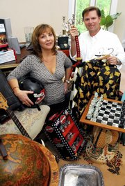 Nancy Baughman and her husband, Daren, display items in their Raleigh, N.C., home that they will be selling on their online auction service, eBizAuctions. Nancy Baughman said she has been working recently with many desperate sellers, instead of mostly casual ones.