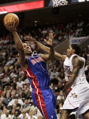 Detroit's Chauncey Billups, left, goes in for a layup as Philadelphia's Lou Williams, right, defends. Behind Billups and his 20 points and seven assists, Detroit crushed Philadelphia, 100-77, on Thursday in Philadelphia. The Pistons won the series, 4-2.