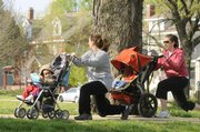 Kelly Valvuena and her son Kaden, 19 months, along with Amy Shumaker and son Cole, 2, work out one of several routines during a Stroller Burn session.