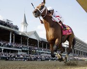 Jockey Kent Desormeaux rides Big Brown to victory. Big Brown won by nearly five lengths Saturday at Churchill Downs in Louisville, Ky.