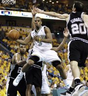 New Orleans Hornets guard Chris Paul (3) passes around San Antonio Spurs forward Manu Ginobili (20). The Hornets won the teams' second-round playoff series opener, 101-82, on Saturday in New Orleans.