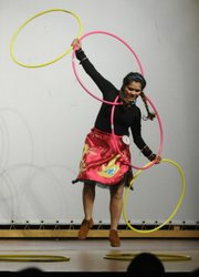 Tila Salas-Brooks, a member of the Yurok tribe and a freshman at Haskell Indian Nations University, performs a hoop dance for her traditional presentation during a Miss Haskell and Haskell Brave 2008-2009 pageant event last week. Students vying for the titles and the honor of representing the school must take part in a variety of competitions.
