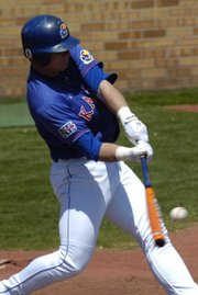 Kansas University outfielder John Allman connects for a home run. Allman was 4-for-5 with two RBIs in the Jayhawks' 13-10 victory over Oklahoma on Saturday at Hoglund Ballpark.