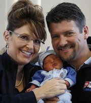 Alaska Governor Sarah Palin and her husband, Todd, hold their baby boy, Trig, in Anchorage, Alaska, in this April 23 file photo. Trig, Palin's fifth child, was born April 18 with Down syndrome.