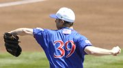 KU pitcher T.J. Walz prepares to deliver a pitch. Walz improved to 4-0 with the victory over OU.