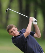 Bishop Seabury Academy freshman Reed Grabill watches his shot from the fairway on the third hole, Monday, May 5, 2008 at Alvamar Golf Course.