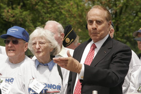 Former Sen. Bob Dole talks with Kansas World War II veterans during an April 30 Honor Flight to Washington, D.C.