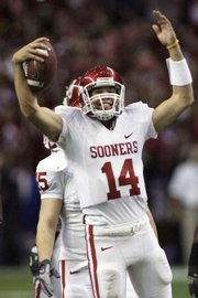 Oklahoma quarterback Sam Bradford (14) reacts in this file photo near the end of the Big 12 Conference championship game from Dec. 1, 2007. Bradford will orchestrate a high-octane offense in Norman this fall.