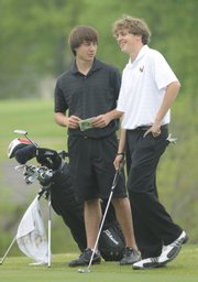 Lawrence High golfer Spencer Scott, left, and Free State's Seth McCauley visit on the No. 8 hole during the Lawrence Invitational. Scott won the individual title at the event Wednesday at Alvamar Public.