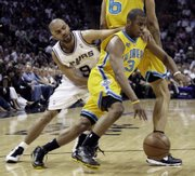 Hornets guard Chris Paul (3) drives past San Antonio's Tony Parker. The Spurs won Thursday in San Antonio.