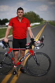 Maj. Brian Rau, a friend of Maj. David Rozelle's, will be competing in the Ironman 70.3 Kansas in June.