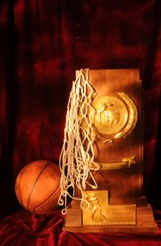 "A photo of the 1988 Kansas University men's basketball championship trophy was used for a Lawrence Journal-World special section earlier this year. ""Light painting"" was utilized to achieve the effect."