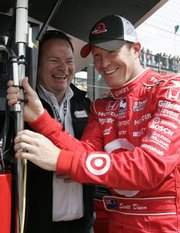 Car owner chip Ganassi, left, and driver Scott Dixon chat after Dixon qualified for the Indianapolis 500. Dixon won the pole with an average speed of 226.366 mph on Saturday in Indianapolis.