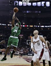 Boston's Paul Pierce, left, puts up a shot over Cleveland's Zydrunas Ilgauskas. The Cavaliers defeated the Celtics, 108-84, on Saturday night in Cleveland.
