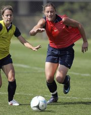 Abby Wambach, right, battles for a ball with Team USA teammate Kace White earlier this week. The team was preparing for a match against Canada, one of its final tuneups before the 2008 Olympics.