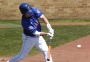 Kansas Senior Joe Southers connects  for a hit in the first game of a doubleheader with Missouri. Kansas won the opener, 7-6, but fell in the nightcap, 12-1, Sunday at Hoglund Ballpark.