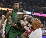 Cleveland's LeBron James, right, drives on Paul Pierce. Cleveland edged Boston, 88-77, on Monday in Cleveland.