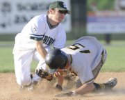 The ball slips away from Free State's Hunter Scheib, left. After a sloppy start, Free State beat SM West, 9-2, on Monday at FSHS.