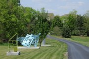Several large sculptures by Jan Gaumnitz align the drive leading up to her home.