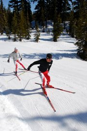 Marshall Greene, right, defending champion of the men's elite division of the U.S. Bank Pole, Pedal, Paddle, trains with elite women's runner-up Sarah Max on the course at the Mount Bachelor Nordic Ski Center outside Bend, Ore.
