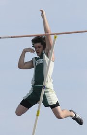 Free State High's Tim Malcolm competes in the pole vault. Malcolm took first with a vault of 13-feet, 6-inches, Friday at the Olathe District Athletic Complex.