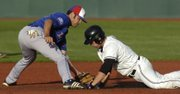 KU's Erik Morrison doesn't quite tag out a K-State baserunner Saturday, May 17, 2008 during the Jayhawks' road game in Manhattan.