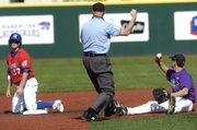 An umpire signals Kansas University's Robby Price out at second base. The Jayhawks fell to Kansas State, 11-10, in their season finale Sunday in Manhattan.