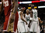 Boston's Paul Pierce (34) is congratulated by teammates Kevin Garnett (5) and James Posey during the fourth quarter of their 97-92 victory over the Cavaliers. Pierce had 41 points in the victory Sunday in Boston.