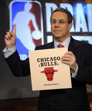 Chicago Bulls executive vice president of business operations Steve Schanwald poses for photographers. The Bulls, which had a 1.7 percent chance of landing the top pick, shockingly won the NBA Draft lottery Tuesday night in Secaucus, N.J.