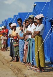 Locals displaced by Cyclone Nargis line up outside their tents as U.N. Secretary-General Ban Ki-moon tours the camp Thursday in Kyondah village, Myanmar. Ban flew into Myanmar's disaster zone Thursday as he pressed the country's leaders to open the doors to critical international aid for some 2.5 million cyclone survivors.