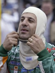 Tony Kanaan suits up for practice for the Indianapolis 500 in this file photo from May 15.