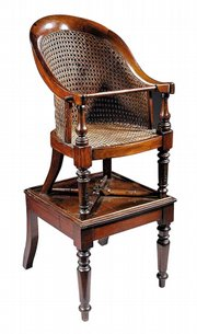 This barrel-back chair with a cane seat stands 37 1/2 inches high. Put it on the separate mahogany stand and it makes a highchair. Neal Auction Co. sold this chair in February for $1,998.
