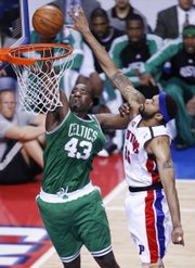 Boston Celtics center Kendrick Perkins (43) dunks on Detroit Pistons center Rasheed Wallace during the first quarter of Game 3. Perkins scored 12 and the Celtics cruised past the Pistons, 94-80, Saturday in Auburn Hills, Mich.