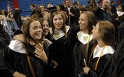From left, graduating classmates Kelly Renfro, Madison Bertrand, Kaylen Fleming, Emily Bracciano and Jaymie Hardtarfer gather in celebration at the end of Lawrence High School's commencement ceremony at Allen Field House Sunday, May 25, 2008.