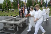 Members of the American Legion Auxiliary unit #14 and Auxiliary Salon #560 of 8 & 40, present the laying of wreaths at the Eternal Flame Monday, May 26, 2008. The women participated in Memorial Day services at the Veterans Plot at Oak Hill Cemetery sponsored by the American Legion Dorsey-Liberty Post #14 of Lawrence.