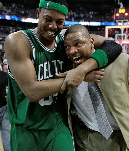 Boston Celtics forward Paul Pierce (34) hugs coach Doc Rivers after the Celtics defeated the Detroit Pistons, 89-81, to win the Eastern Conference finals. The Celtics advanced to the NBA finals with the victory Friday in Auburn Hills, Mich.