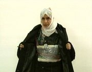 Iraqi Sajida al-Rishawi opens her jacket and shows an explosive belt as she confesses on Jordanian state-run television to her failed bid to set off an explosives belt inside one of the three Amman hotels in this file image made from television on Nov. 13, 2005. Women have carried out or attempted at least 20 suicide bombings since 2003 in the Iraq branch of al-Qaida.