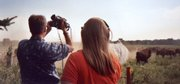 "Filmmakers Kelly and Tammy Rundle record a buffalo stampede at the Hawkeye Buffalo Ranch near Fredericksburg, Iowa. The Rundles recently completed ""Lost Nation: The Ioway,"" a film about the tribe that is the namesake for the state of Iowa."